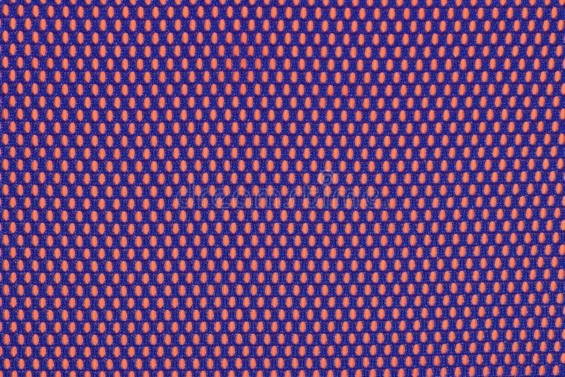 Голубая ткань nonwoven на апельсине стоковые изображения rf