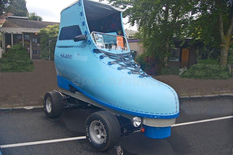 Голубой автомобиль конька ролика стоковое фото rf