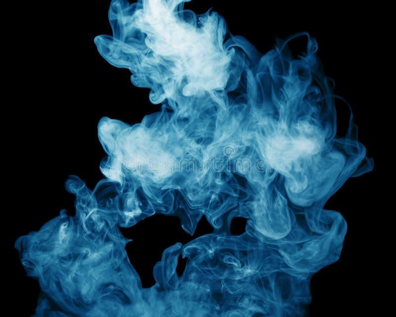Голубой пар на черной предпосылке стоковая фотография rf