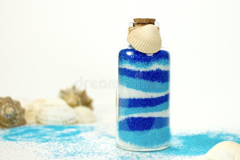 Голубой песок в бутылке стоковые изображения rf