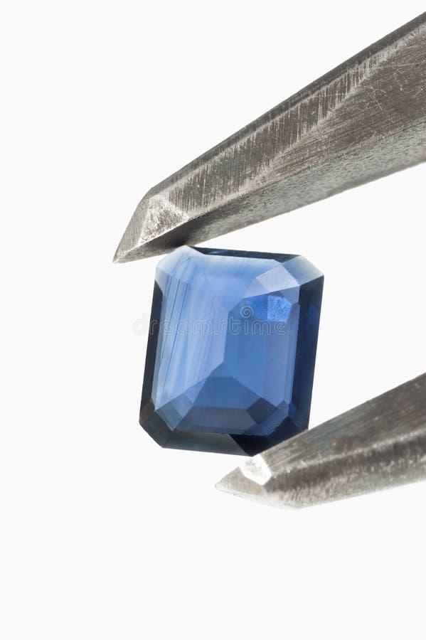 Голубой самоцвет топаза в изолированном крумциркуле стоковое изображение rf