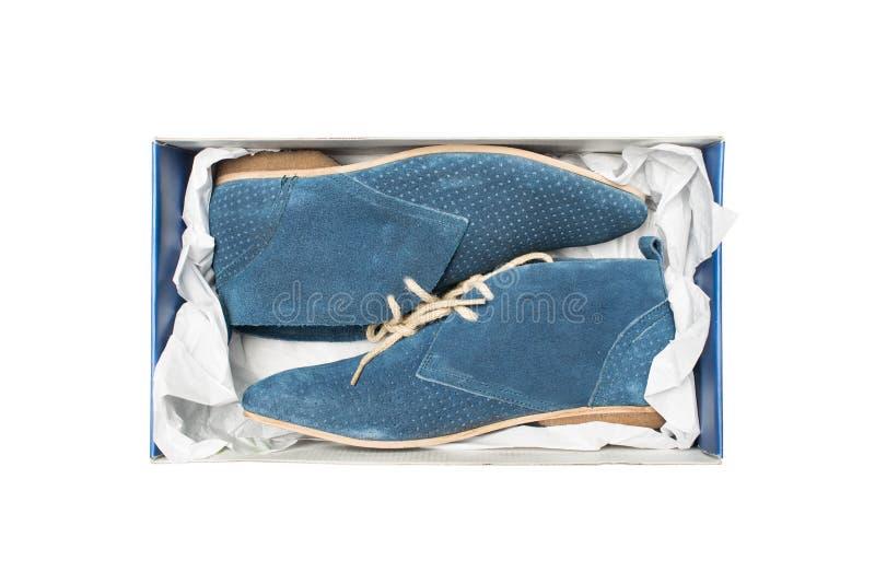 Голубые ботинки в коробке стоковое фото