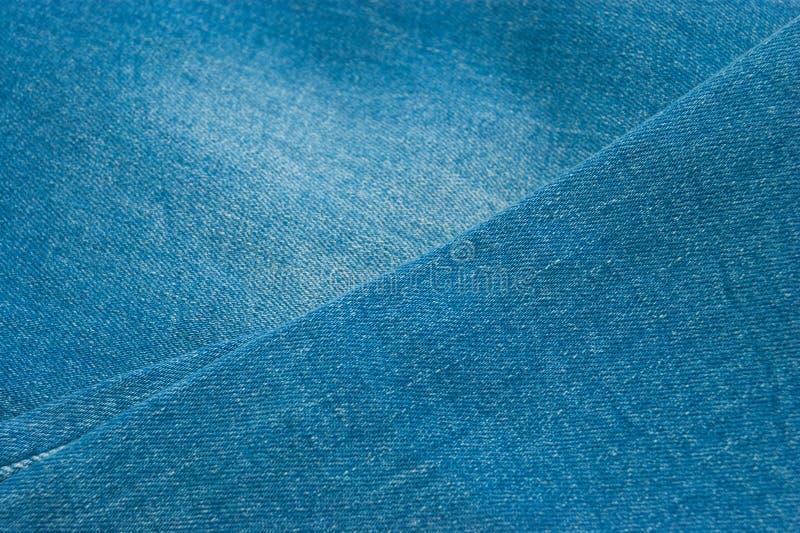 голубые джинсы предпосылки славные стоковые изображения