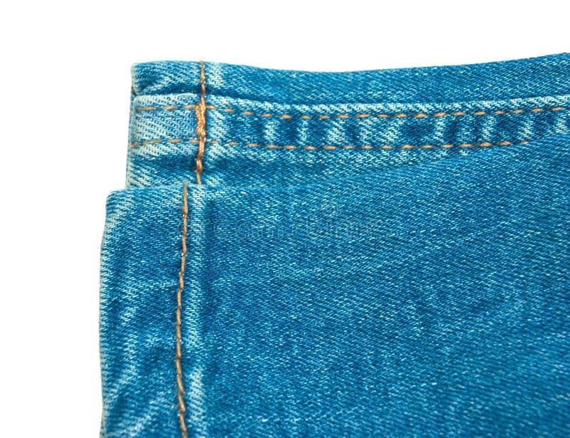 голубые изолированные джинсыы стоковые изображения rf