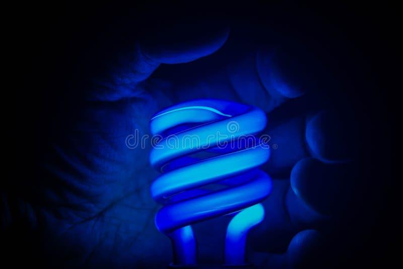 Голубые неоновое свето & рука стоковые изображения rf
