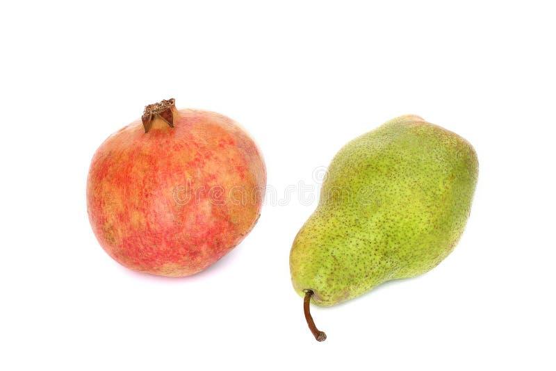 Гранатовые деревья и груша плода на белой предпосылке стоковые фото