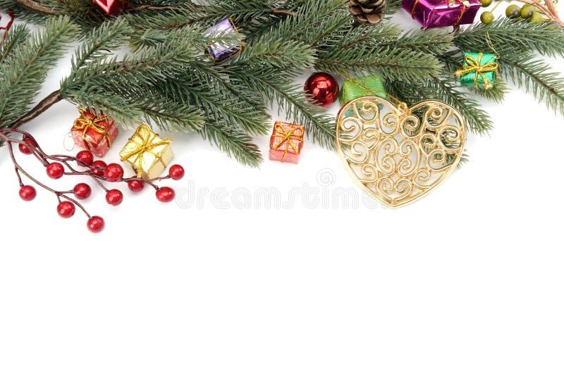 Граница рождества безделушек, гирлянды и конфеты стоковое изображение