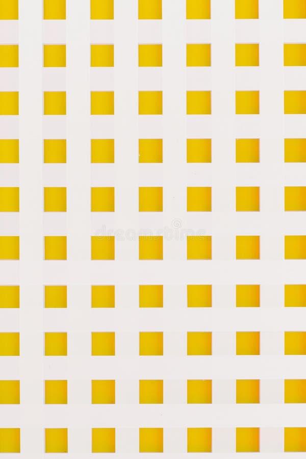График белых нашивок предпосылки желтый квадратный стоковые изображения