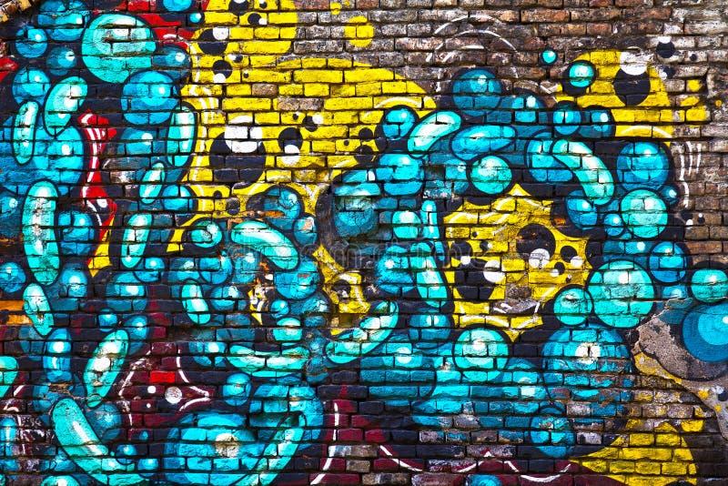 Граффити кирпичной стены стоковые фотографии rf