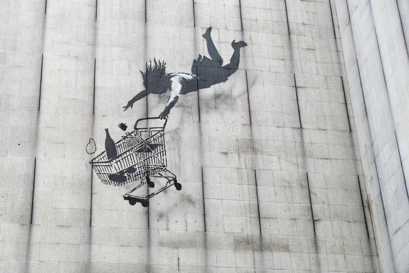 Граффити покупателя Banksy падая стоковое фото rf