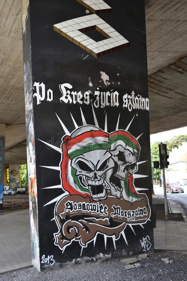 Граффити с черепами и символами футбола Legia Варшавы бьют стоковые изображения