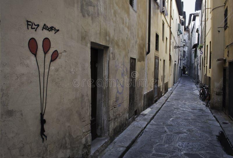 Граффити улицы мухы отсутствующие флорентийские стоковые изображения
