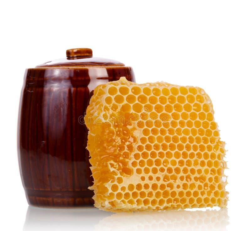 Гребень меда с баком стоковое изображение