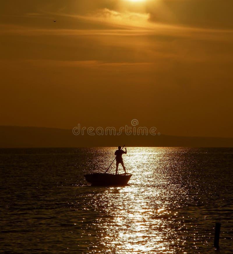 Грести в заходе солнца 4 стоковая фотография