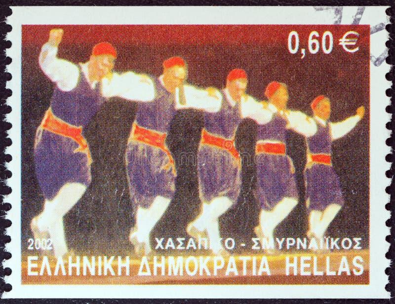 ГРЕЦИЯ - ОКОЛО 2002: Печать напечатанная в танце Hassapiko шоу Греции, Smyrna, около 2002 стоковое изображение
