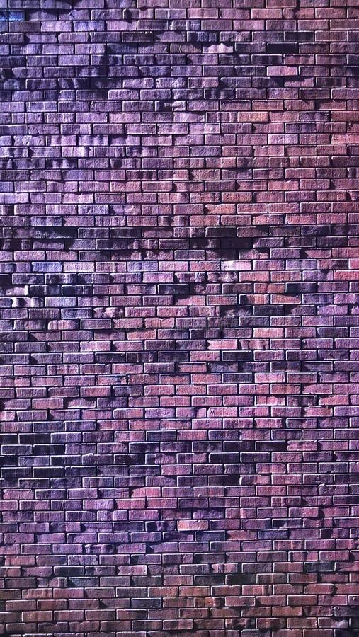 Грубая кирпичная стена стоковые фото