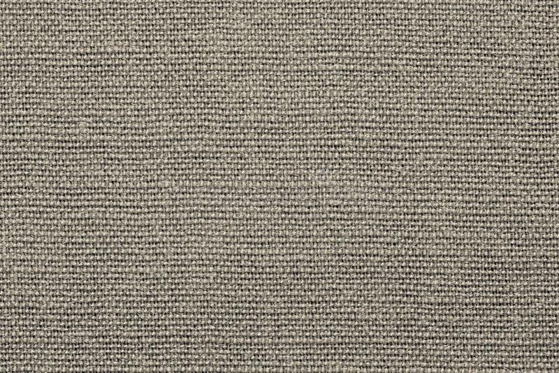 Грубая grained ткань текстуры бежевого цвета стоковые изображения