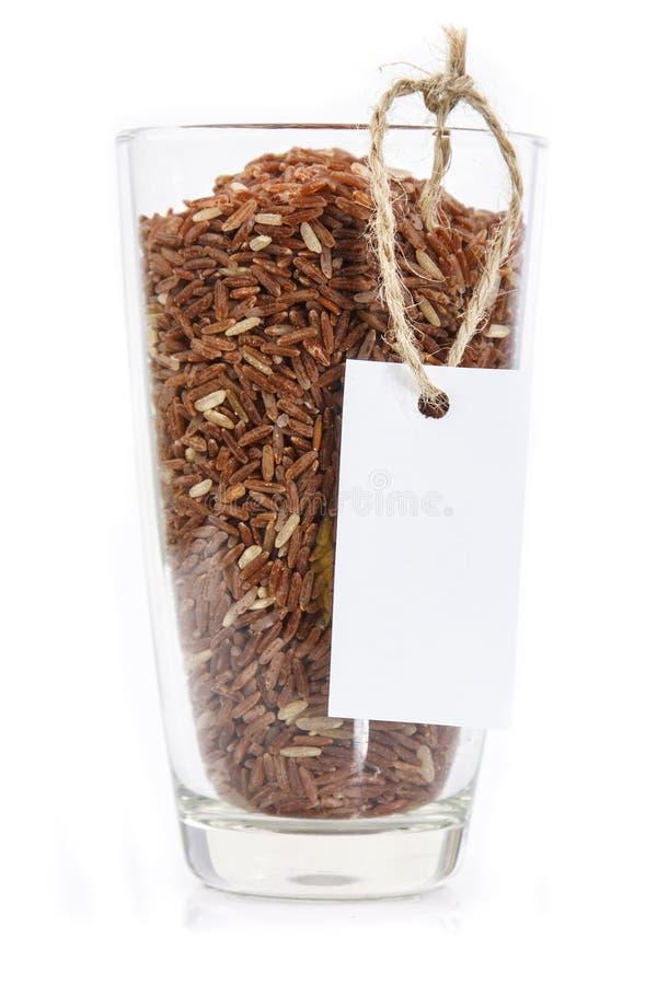 Download Грубое зерно риса в стекле с биркой Стоковое Фото - изображение насчитывающей backhoe, здорово: 33736158