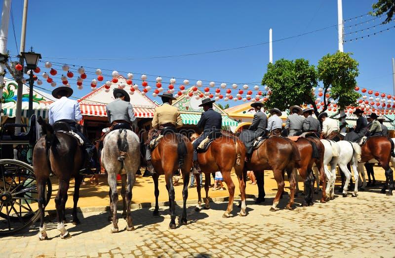 Группа в составе всадники во время Севильи справедливой, Андалусии, Испании стоковые фотографии rf