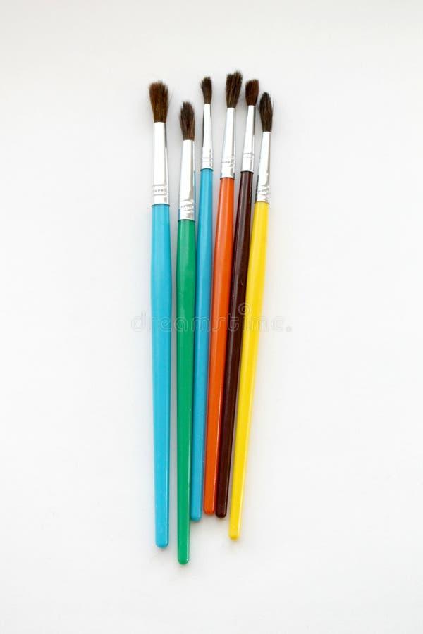 Группа в составе красочные paintbrushes на белой предпосылке стоковое изображение