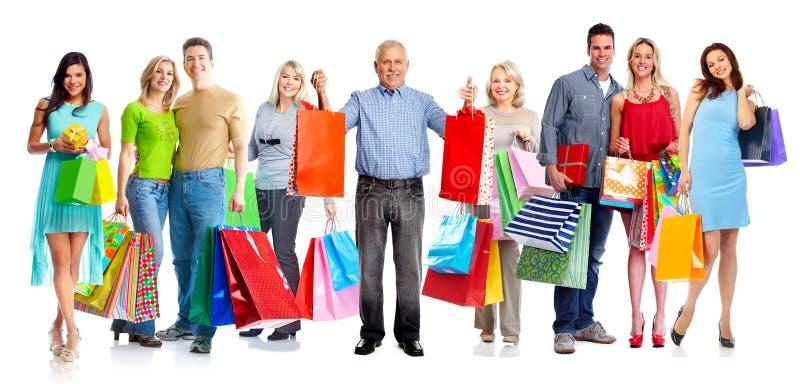 Группа в составе клиенты с хозяйственными сумками стоковое изображение