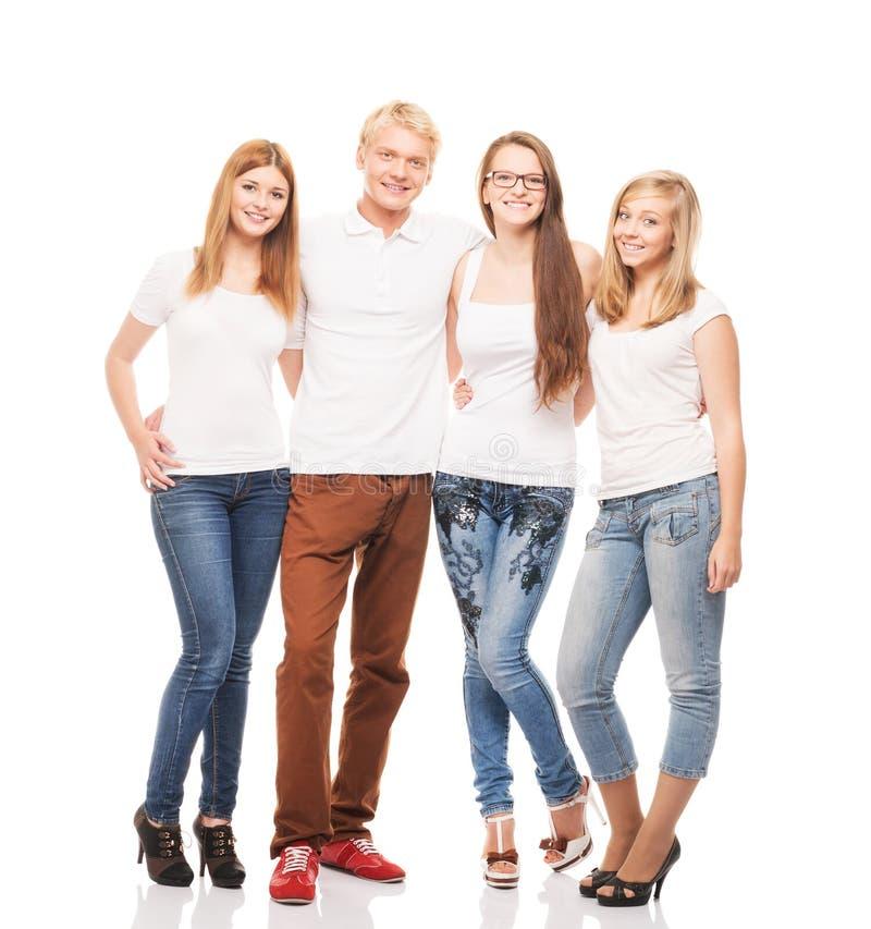 Группа в составе молодые, стильные и счастливые подростки изолированные на белизне стоковые фотографии rf