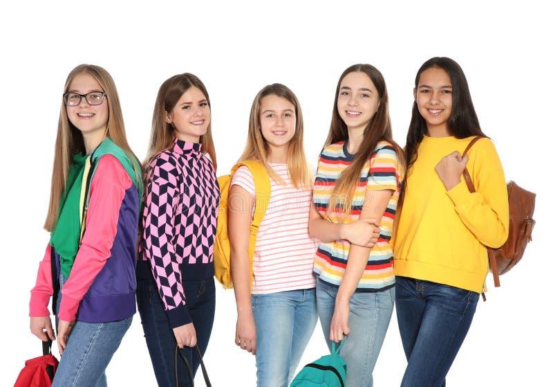 Группа в составе подростки на белой предпосылке стоковые изображения rf