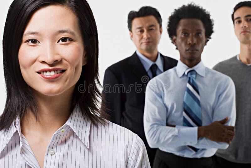 Группа в составе 4 работника офиса стоковое изображение