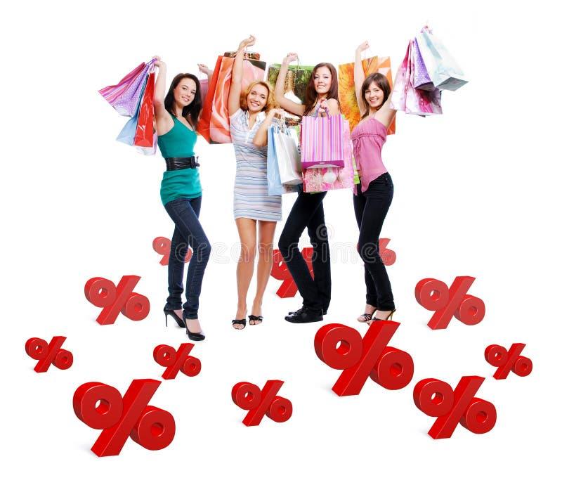 Группа в составе счастливые женщины с хозяйственными сумками стоковая фотография rf