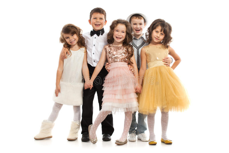 Группа в составе счастливые дети в праздничных одеждах стоковое фото
