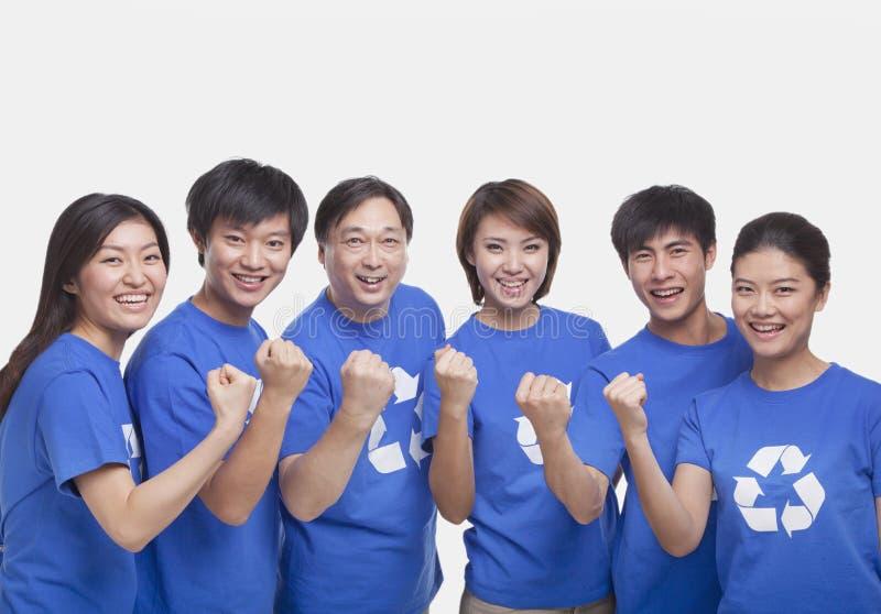 Группа людей с поднятыми кулаками, съемка студии стоковые фотографии rf