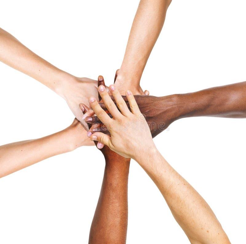 Группа людей штабелируя их руки совместно стоковое фото rf