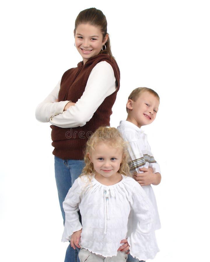 группа 3 детей стоковые фото