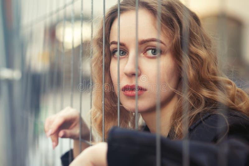 Девушка за решеткой стоковое фото rf