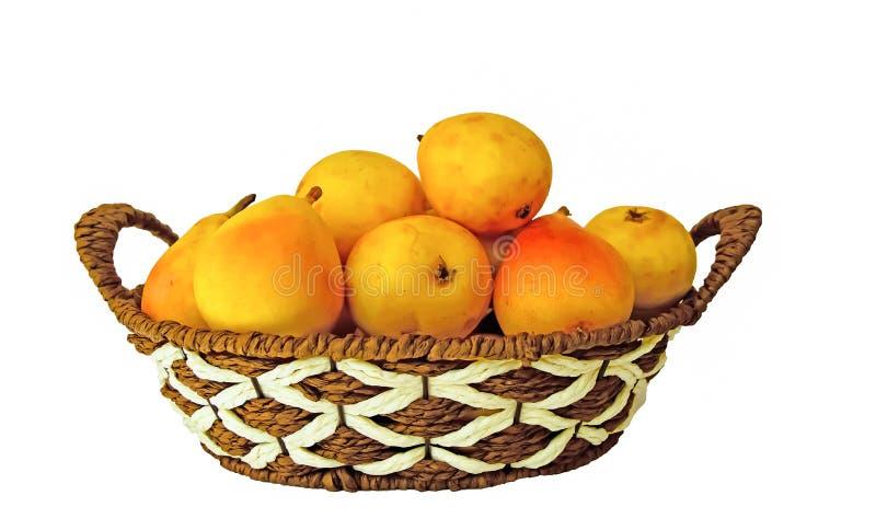 Груши в корзине на белой предпосылке стоковое фото rf