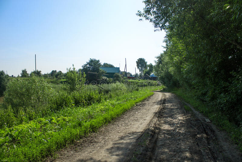 Грязная улица в деревне стоковая фотография
