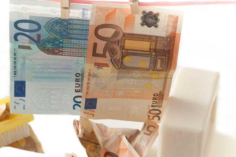Грязные деньги и вид мытья стоковые фото