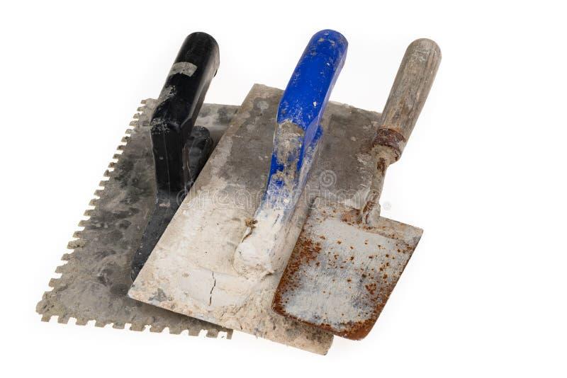 Грязный штукатуря гипсолит на таблице мастерской Инструменты для рабочий-строителей стоковые изображения rf