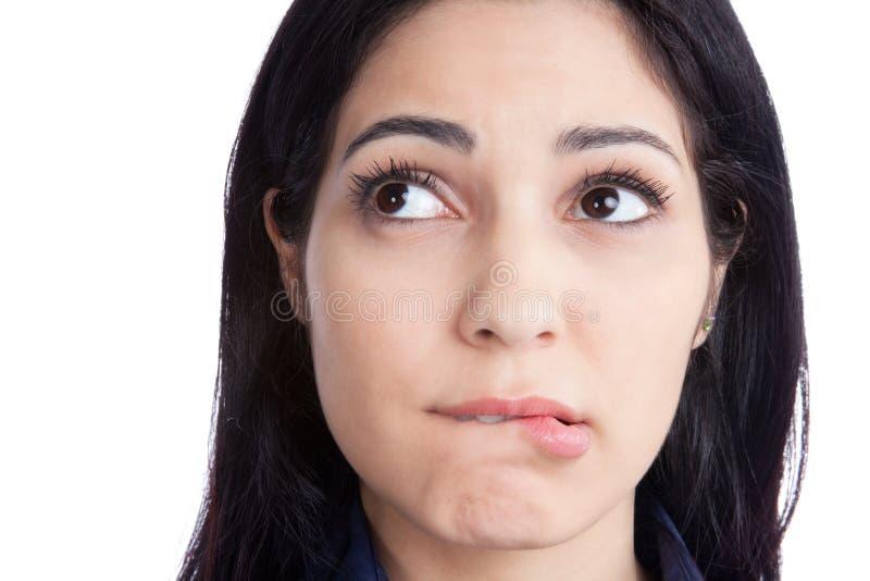 Губы счастливой молодой женщины сдерживая стоковые фотографии rf