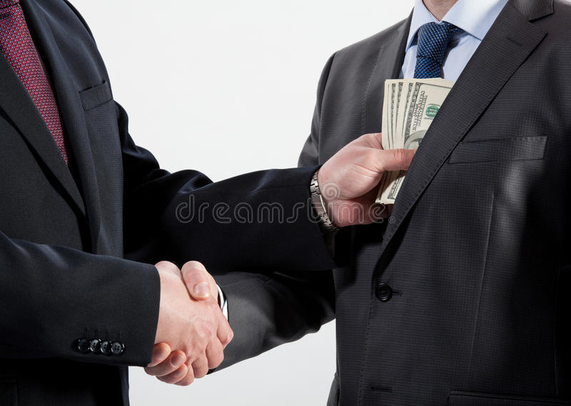 Давать взятку в карманн стоковые фото
