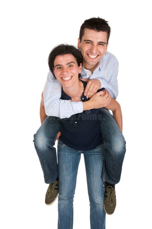 дает сестру piggyback стоковое изображение