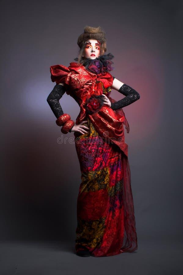 Дама в красном цвете. стоковая фотография