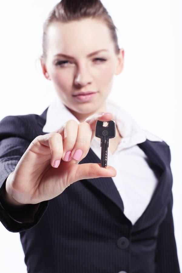 Дама дела с ключом стоковые фото