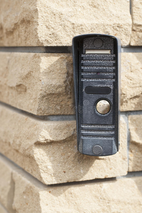 Дверной звонок на стене стоковая фотография