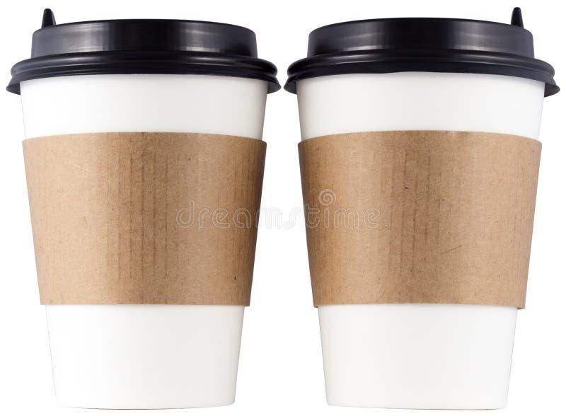Две бумажные чашки кофе, изолированные на белом фоне стоковая фотография