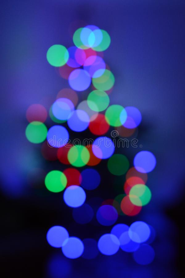 Двигая света против голубой предпосылки - другие цвета стоковые изображения rf
