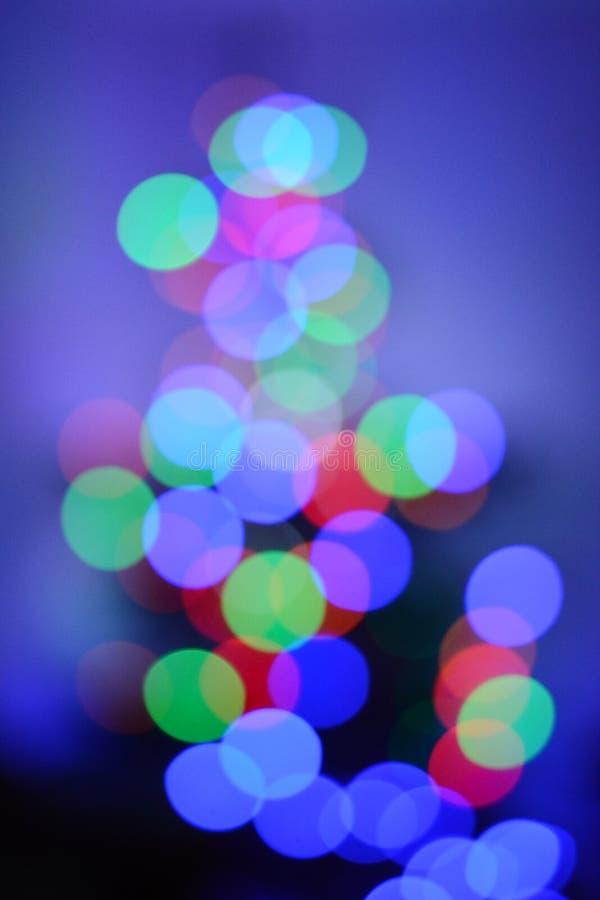 Двигая света против голубой предпосылки - другие цвета стоковая фотография