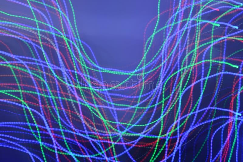Двигая света против голубой предпосылки - другие цвета стоковые изображения