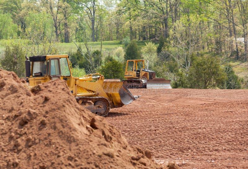 движенец земли земли землекопа расчистки большой стоковые фото