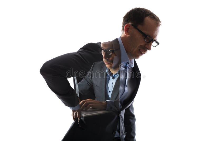 Двойная экспозиция бизнесмена имея Backache и работу стоковые изображения rf